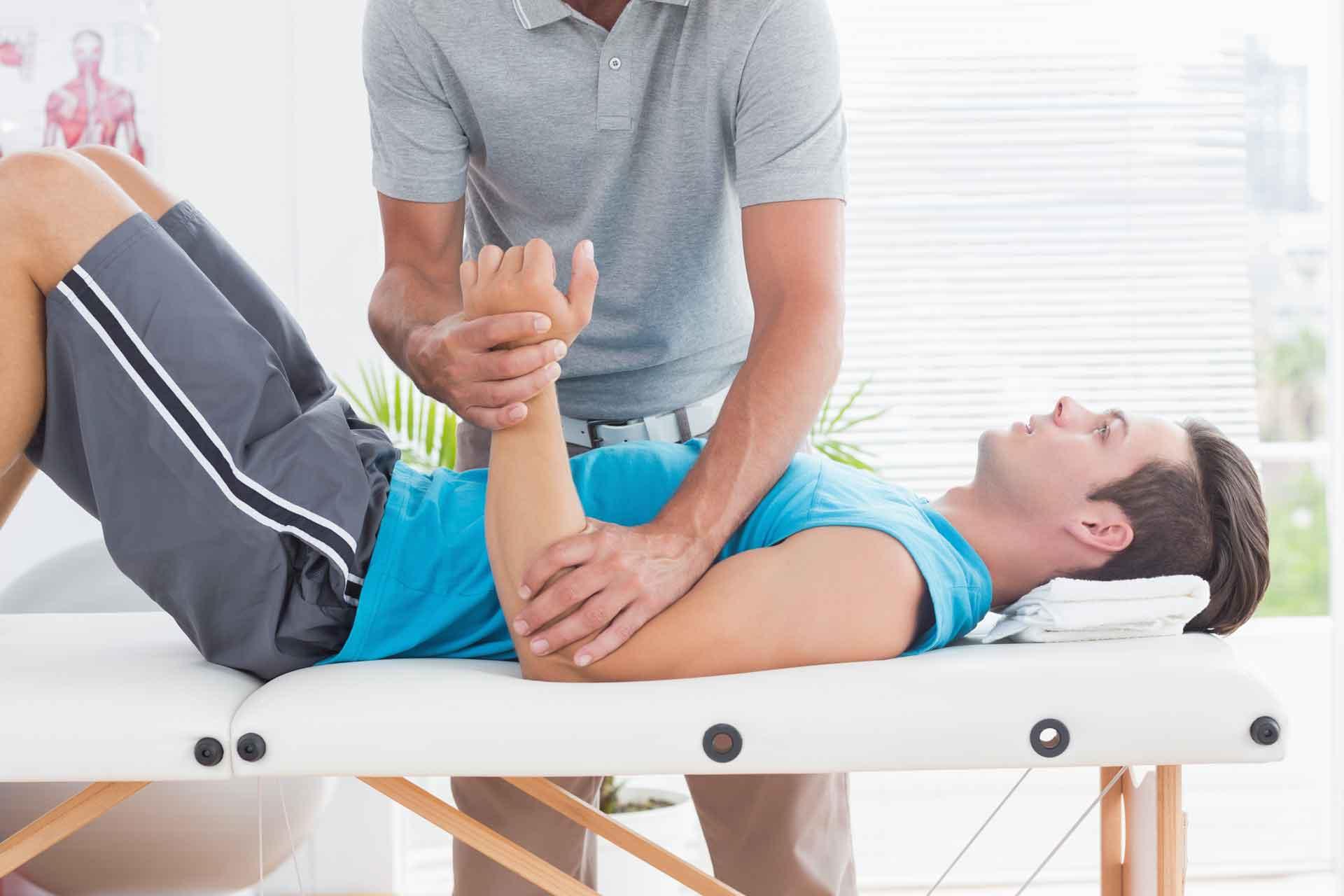A registered massage therapist massages the right arm of a man richmond rmt massage